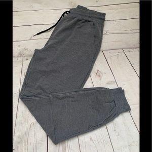 Men's grey joggers with loop & zipper pockets